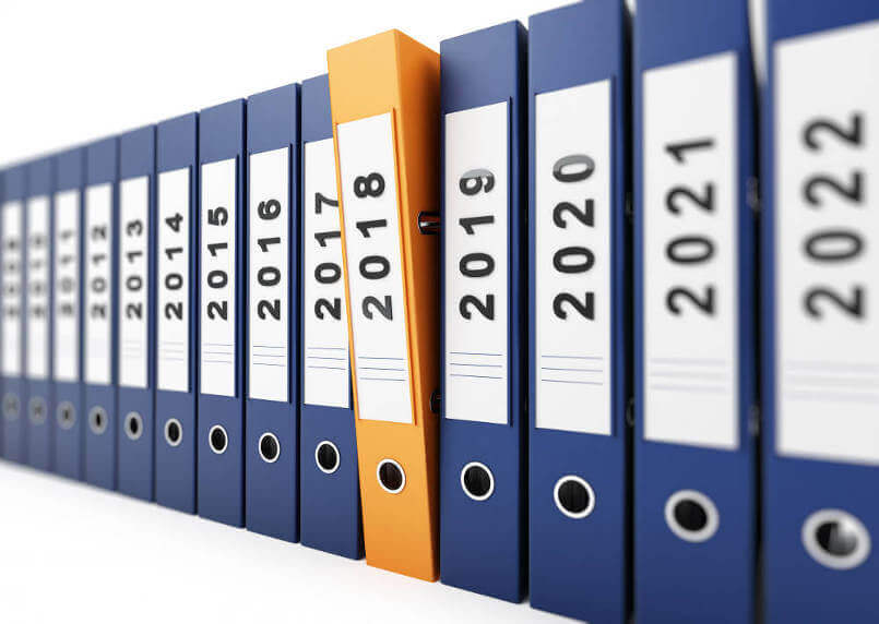 blue-box-files-in-a-line-labled-with-year-dates